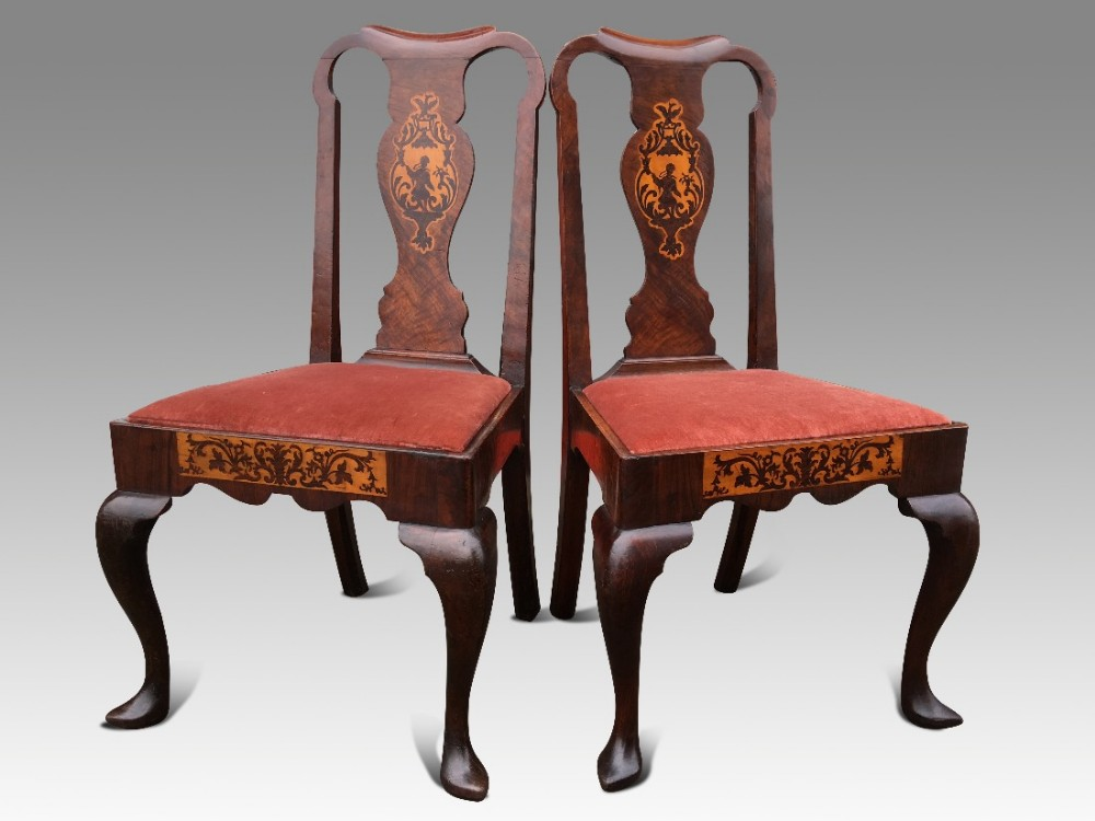 a superb pair of irish early 18th c walnut and marquetry side chairs