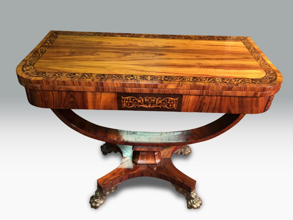 a superb regency goncalo alves holly inlaid card table in the manner of george oakley
